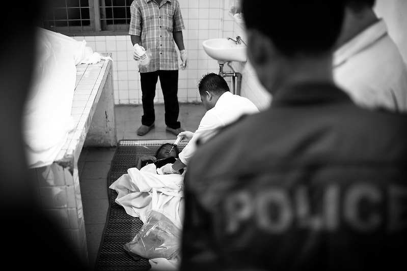 A yet unidentified victim is embalmed at Calmette Hospital in Phnom Penh, Cambodia. Nearly 400 perished on November 22nd 2010 when an unknown event caused panic and thousands tried to flee Diamond Island over a small bridge connecting it to the river bank. (Quinn Ryan Mattingly)