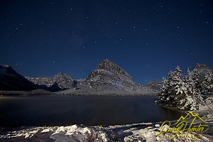 "Swiftcurrent Lake under the stars, Mt. Grinnell towers over the lake as it reaches into the night sky. (© Daryl Hunter's ""The Hole Picture""/Daryl L. Hunter)"