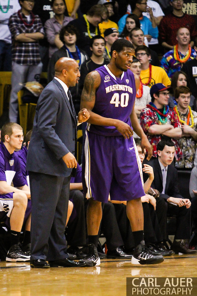 February 9th, 2014:  Washington Huskies head coach Lorenzo Romar talks to junior forward Shawn Kemp, Jr. (40) during a break int he first half action of the NCAA Basketball game between the Washington Huskies and the University of Colorado Buffaloes at the Coors Events Center in Boulder, Colorado (Carl Auer/ZUMAPRESS.com)