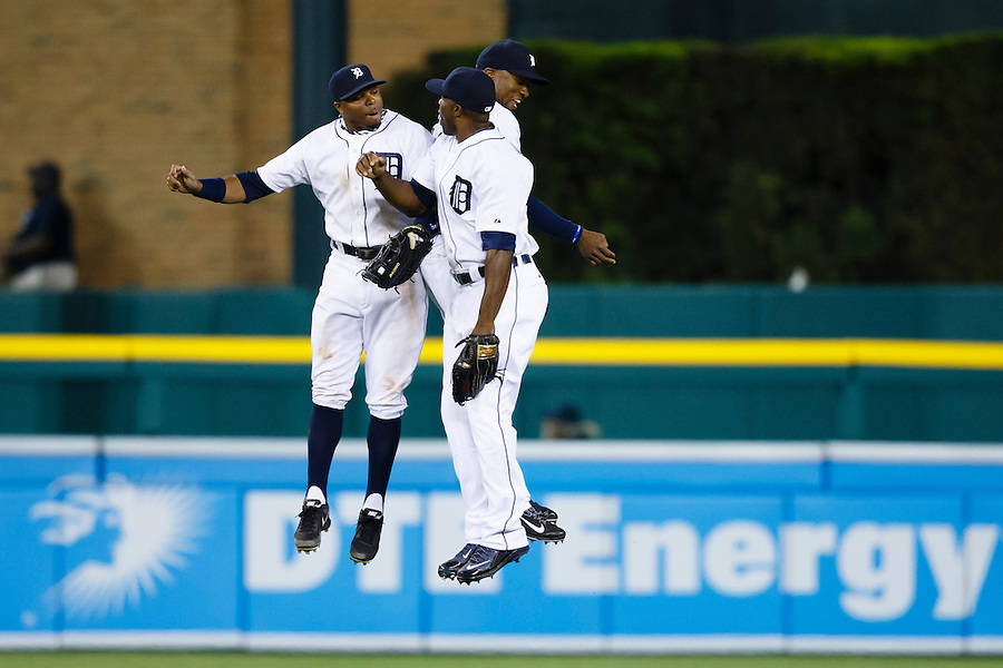 May 23, 2014; Detroit, MI, USA; Detroit Tigers left fielder Rajai Davis (left) right fielder Torii Hunter (center) and  center fielder Austin Jackson (right) celebrate after the game against the Texas Rangers at Comerica Park. Detroit won 7-2. Mandatory Credit: Rick Osentoski-USA TODAY Sports (Rick Osentoski/Rick Osentoski-USA TODAY Sports)