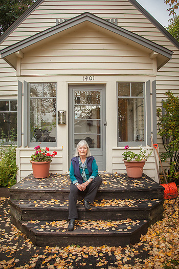 Lanie Fleischer in front of her home in Anchorage. (© Clark James Mishler)