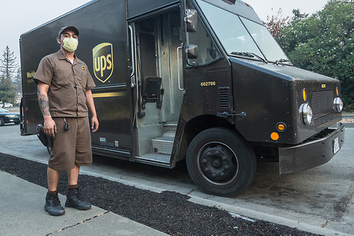 """I'm a little light-headed, I have a headache and my eyes hurt...I'm ready to call it a day.""  UPS driver Oscar Soltero fights the smoke from wild fires north of Martinez, CA (Clark James Mishler)"