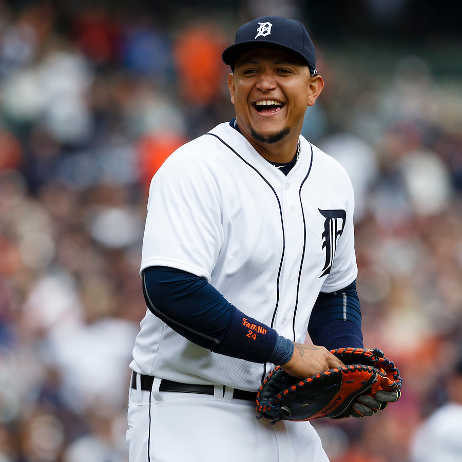 Apr 6, 2015; Detroit, MI, USA; Detroit Tigers first baseman Miguel Cabrera (24) smiles towards the Minnesota Twins dugout as he walks out to start the ninth inning at Comerica Park. Detroit won 4-0. Mandatory Credit: Rick Osentoski-USA TODAY Sports (Rick Osentoski/Rick Osentoski-USA TODAY Sports)