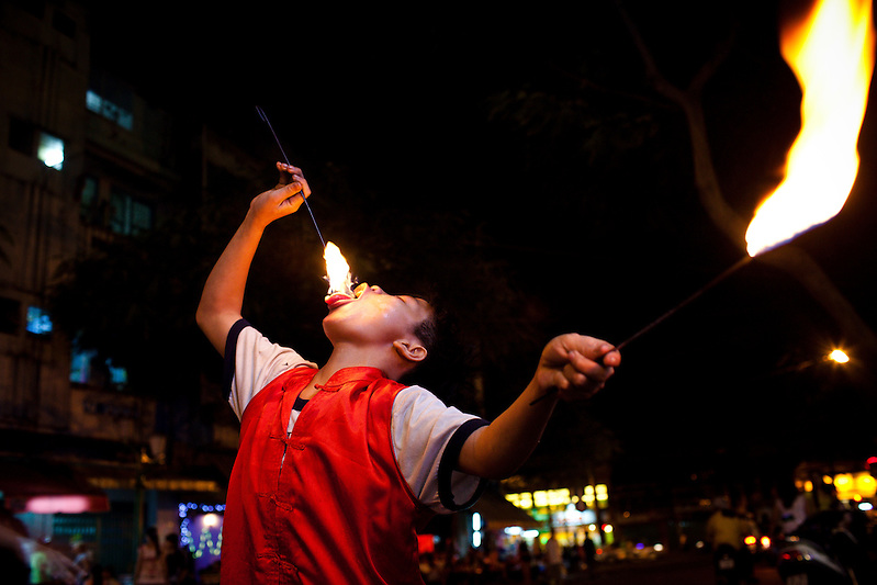 In the backpacker district of Saigon, Vietnam, youth employ fire eating as a means of income. Often, they receive little or nothing from viewers. (Quinn Ryan Mattingly)
