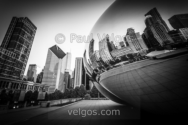 "Chicago ""The Bean"" Cloud Gate sculpture in black and white with a reflection of downtown Chicago city buildings. (Photographer: Paul Velgos)"