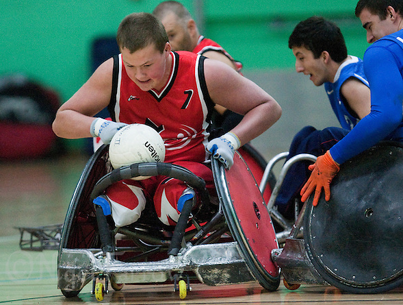 15 AUG 2011 - LEEDS, GBR - Canada's Zak Madell (left) attempts to avoid a challenge from Great Britain's David Anthony (right) during the wheelchair rugby exhibition match between the two teams .(PHOTO (C) NIGEL FARROW) (NIGEL FARROW/(C) 2011 NIGEL FARROW)