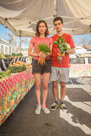 Graphic design student Malina Mikami shops with her boy friend and CIA student, Carlos Mussali, at the Calistoga Saturday Farmer's Market. (Clark James Mishler)