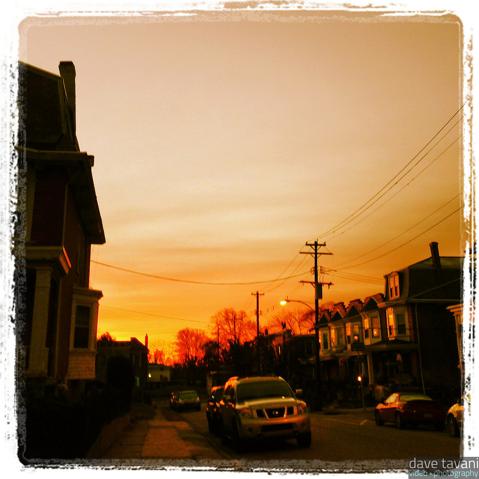 The eastern sky blazes with an orange glow just before sunrise, as seen from Cherokee Street in the Germantown section of Philadelphia, December 20, 2012. (Dave Tavani)