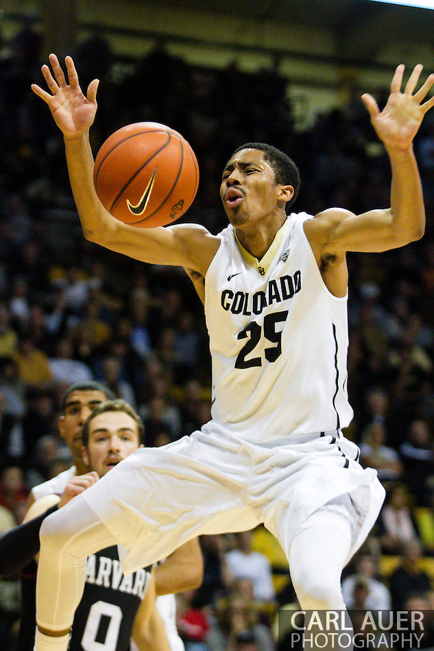 November 24th, 2013:  Colorado Buffaloes junior guard Spencer Dinwiddie (25) loses control of the ball on the way to the basket in the second half of the NCAA Basketball game between the Harvard Crimson and the University of Colorado Buffaloes at the Coors Events Center in Boulder, Colorado (Carl Auer/ZUMAPRESS.com)