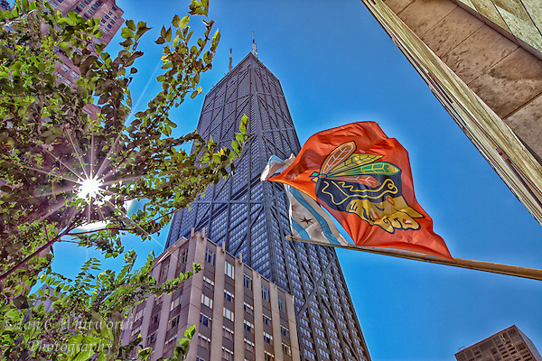 The proud Blackhawks flag flies in the foreground will looking up at Chicago's John Hancock Tower. (Ian C Whitworth)