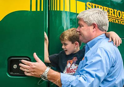Superior Transportation CEO helps son climb into Mack truck