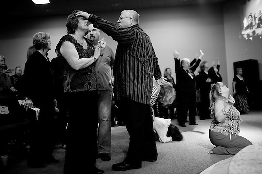 "Senior Pastor Rich Oliver, center, puts his hand on the head of a member of ""The Family"" church during Sunday services in Roseville, Calif., January 16, 2011..CREDIT: Max Whittaker for The Wall Street Journal.FORCHURCH (Max Whittaker/Prime)"