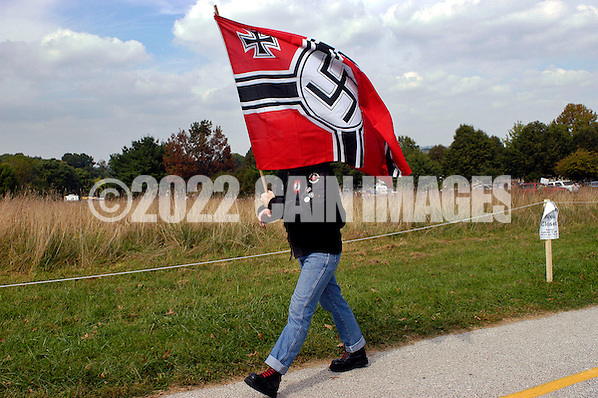 VALLEY FORGE, PA - SEPTEMBER 25: An American Nazi party member arrives carrying a Nazi flag for an American Nazi rally at Valley Forge National Park September 25, 2004 in Valley Forge, Pennsylvania. Hundreds of American Nazis from around the country were expected to attend. (Photo by William Thomas Cain/Getty Images) (William Thomas Cain/Getty Images)