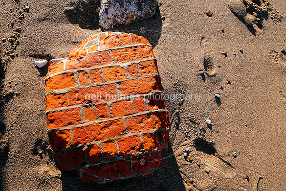 Spurn Head, Spurn, East Yorkshire, United Kingdom, 06 December, 2014. Pictured: part of a brick structure eroded by the sea (Neil Holmes)