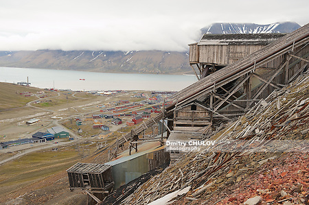 LONGYEARBYEN, NORWAY - SEPTEMBER 01, 2011: View to the town of Longyearbyen with the abandoned coal mine at the foreground, Norway. (Dmitry Chulov)