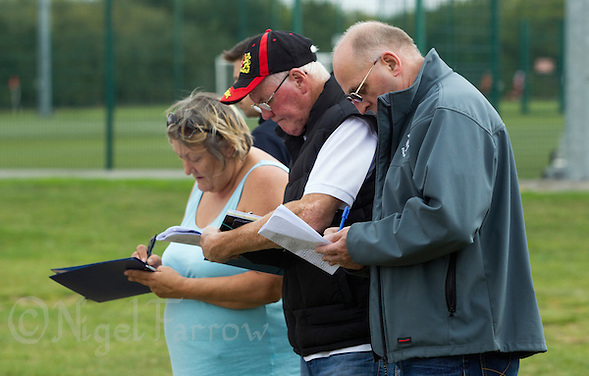 13 SEP 2014 - IPSWICH, GBR - Team officials prepare scoresheets before the start of the 2014 British Open Club Cycle Speedway Championships at Whitton Sports & Community Centre in Ipswich, Great Britain (PHOTO COPYRIGHT © 2014 NIGEL FARROW, ALL RIGHTS RESERVED) (NIGEL FARROW/COPYRIGHT © 2014 NIGEL FARROW : www.nigelfarrow.com)