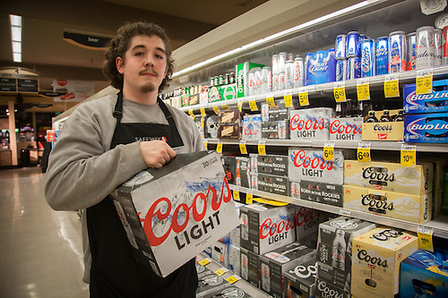 "Keifer Plummer stacks shelves at the Safeway in Pleasant Hill California.  ""I would like to be a cook someday.""  keiferp78@gmail.com (© Clark James Mishler)"