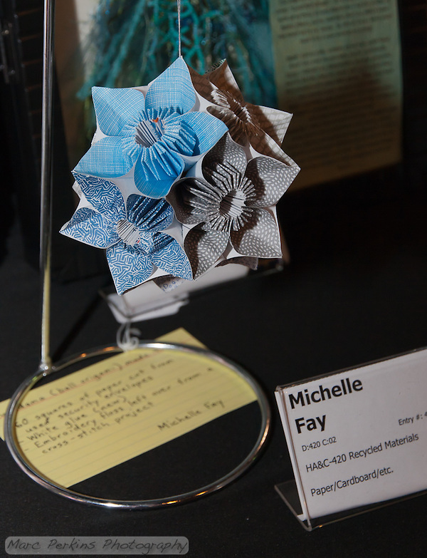 "Michelle won first place  at the 2011 OC Fair for a kusudama (ball origami) project that made from recycled security envelopes.  This is the way her project was displayed.  Each individual unit of each flower was folded from a 4""x4"" square of paper cut out from a security envelope we"