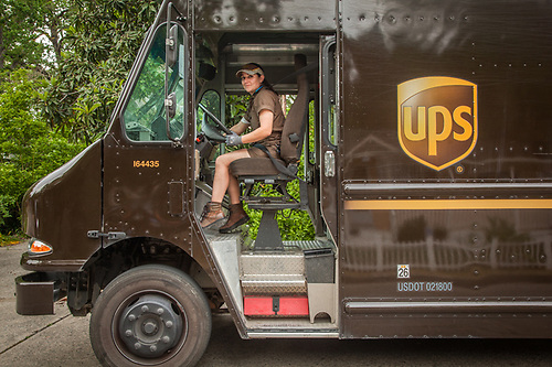 """UPS delivery person Chantal Cook on Myrtle Street in Calistoga. """"I live in Middletown but I deliver all over...Calistoga is my favorite...I love the mountains."""" (Clark James Mishler)"""