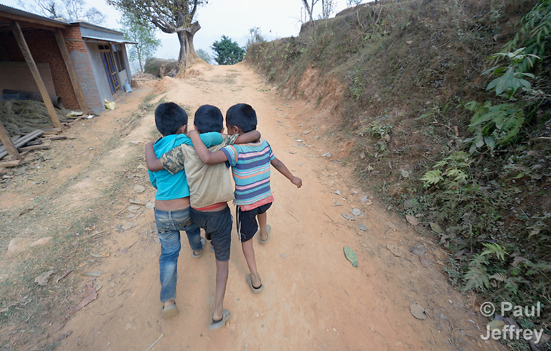 Boys walk along a road in Dhawa, a village in the Gorkha District of Nepal. (Paul Jeffrey)