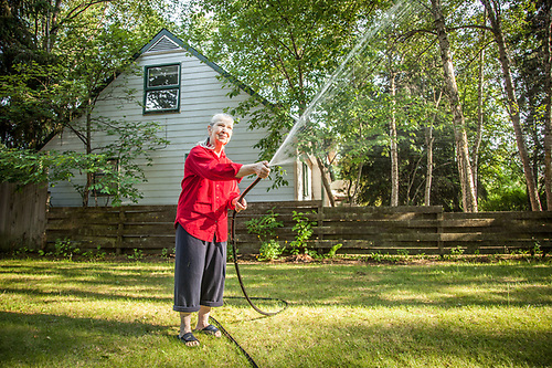 Retired high school teacher Marilyn Conaway in her front yard in the Roger's Park neighborhood of Anchorage. (© Clark James Mishler)