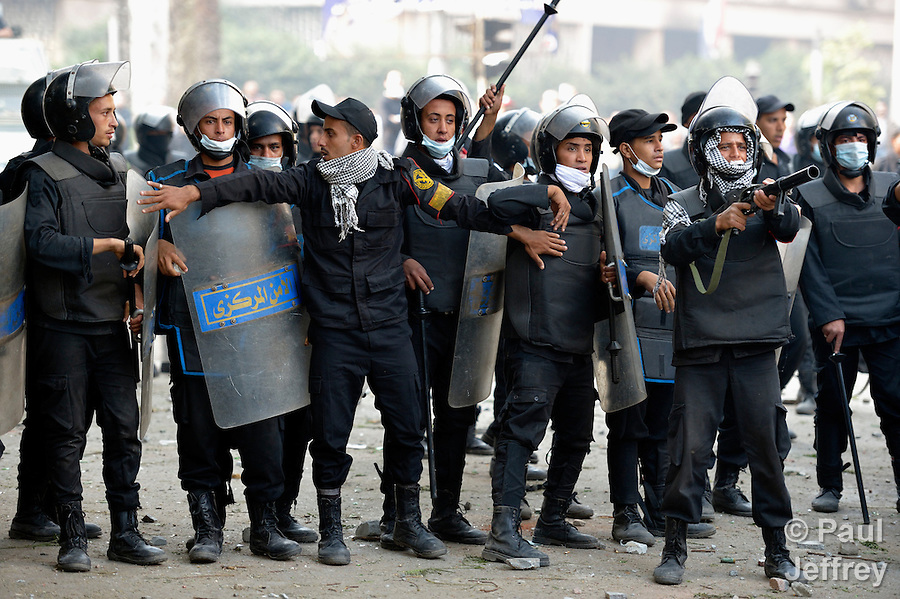 Police face off against demonstrators during November 27, 2012, protests in Cairo's Tahrir Square. The protestors were upset by Egyptian President Mohammed Mursi's November 22nd decision to assume sweeping new powers.