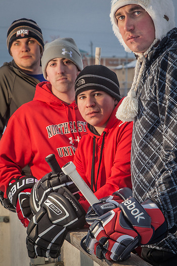 US Army members (Right to Left) Philip Sakala, Philip Diaz, Shaun Sullivan, and Adam Harpham take a break from their hockey game on the Delaney Park Strip, Anchorage. (Clark James Mishler)
