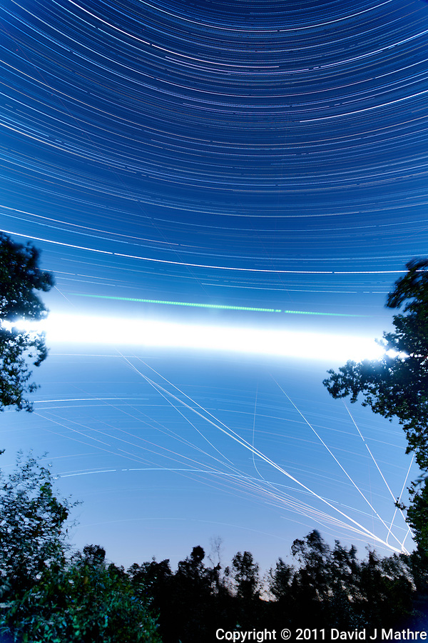 Star Trails - Southern Sky View (19:30-0545). Composite of images taken with a Nikon D3x camera and 14-28 mm f/2.8 lens (ISO 100, 14 mm, f/2.8, 119 sec exposures). (David J Mathre)