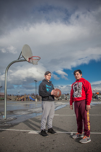 "Ron Bares and his brother Angelo play basketball on the first warm day in a week at Chugach Elementary School, Anchorage  ""I work at McDonalds but I hope to find a better job.""  -Ron Bares   bares_raphael@yahoo.com (© Clark James Mishler)"