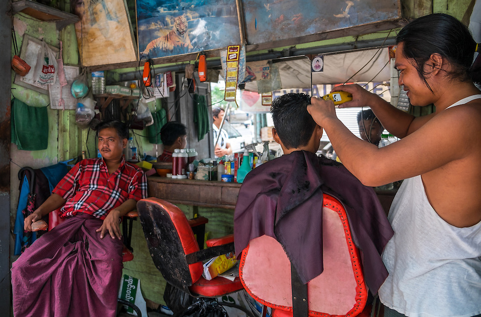YANGON, MYANMAR - CIRCA DECEMBER 2013: Barbershop in the streets of Yangon. (Daniel Korzeniewski)