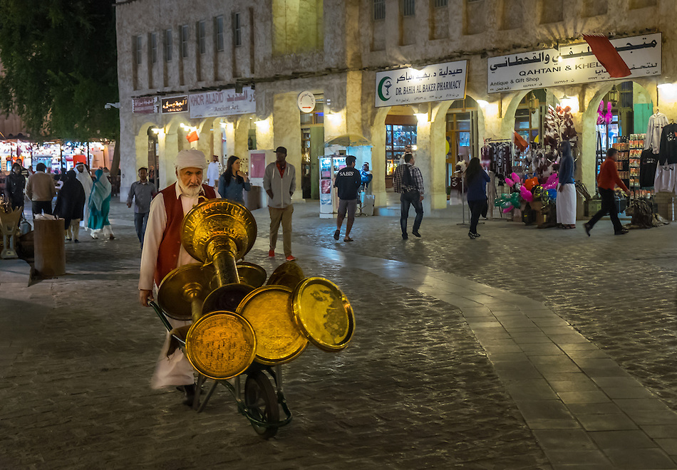 DOHA, QATAR - CIRCA DECEMBER 2013: People walking over at the Souq Waqif. This is a popular and traditional market bazaar in Doha. (Daniel Korzeniewski)