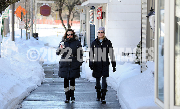 Jill McDade (left) and Michelle Cunningham, both of Newtown, Pennsylvania walk along State Street as the region cleans up after Winter Storm Jonas Sunday January 24, 2016 in Newtown, Pennsylvania. (Photo by William Thomas Cain) (William Thomas Cain/Cain Images)