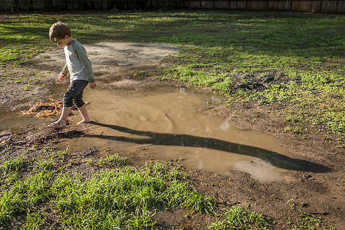 "So, what is it you like about mud? ""Ahh...pretty much everything."" -Five year old Ryley Macleod plays in a puddle adjacent to his house on Maggie Street in Calistoga. (Clark James Mishler)"