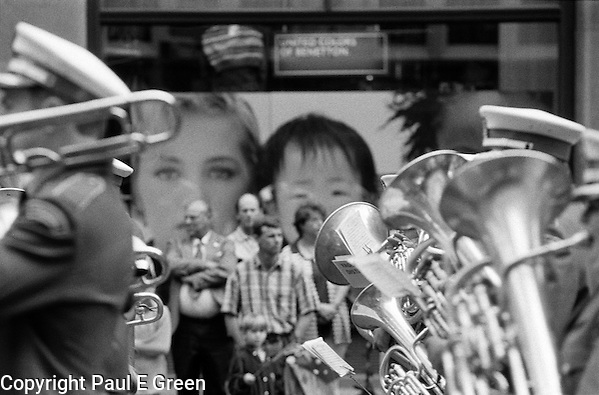 Photography of Sydney by Paul Green, Anzac Day Parade George St Sydney,Black and White, Brass band and poster in background, (Paul Evan Green)