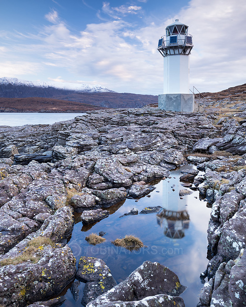 The lighthouse at Rhue, north of Ullapool in northwest Scotland, looks ghostly as it blends with the background. Set at the head of Loch Broom it enables seafarers to navigate into port. It is unmanned, and not actually that large, maybe 25 feet tall. The setting is spectacular though. (Andrew Tobin)