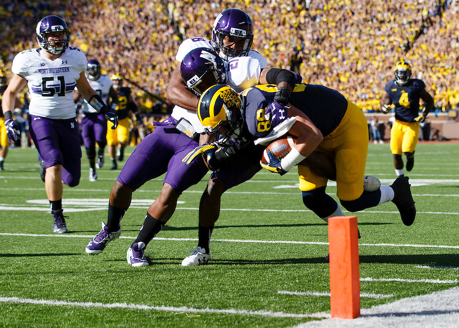 Oct 10, 2015; Ann Arbor, MI, USA; Michigan Wolverines tight end Jake Butt (88) is tackled just short of the end zone by Northwestern Wildcats cornerback Matthew Harris (27) in the first quarter at Michigan Stadium. Mandatory Credit: Rick Osentoski-USA TODAY Sports (Rick Osentoski/Rick Osentoski-USA TODAY Sports)