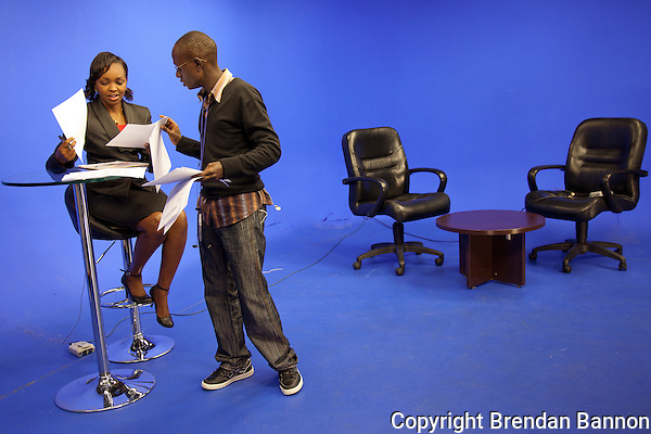 Peninah Karibe, news anchor, preparing for the 1 p.m. newscast at NTV on the day  senior Kenya's appeared at the International Criminal Court on charges. (Brendan Bannon)