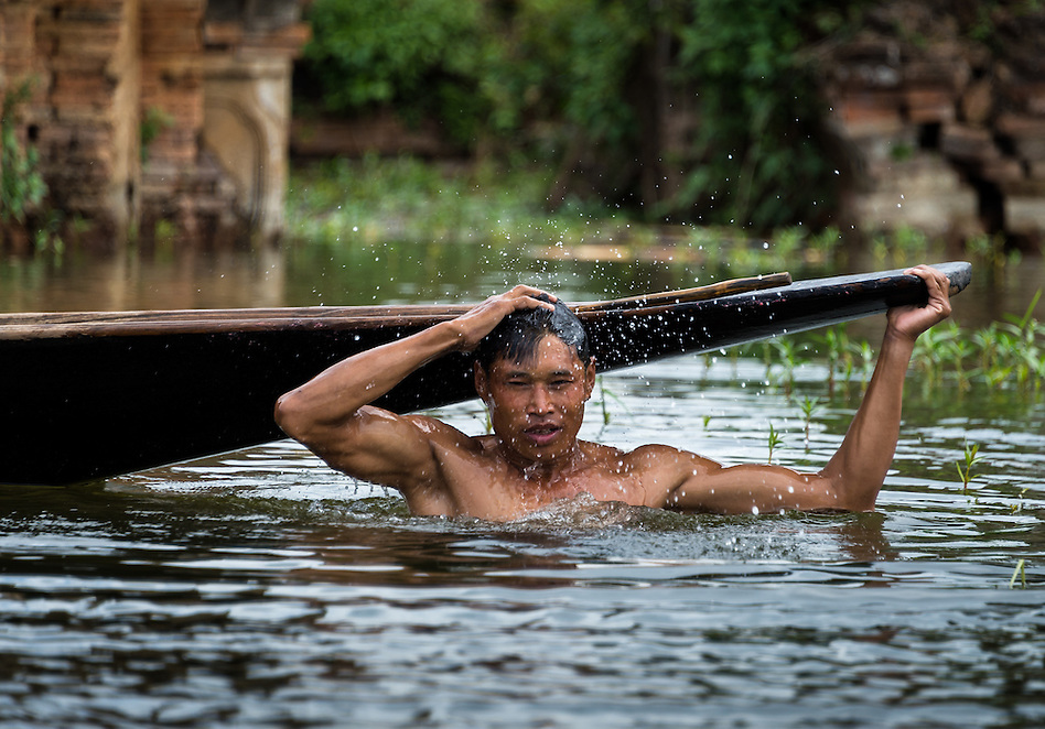 INLE LAKE, MYANMAR - CIRCA DECEMBER 2013: Burmese man taking a bath in Sankar village (or Samka ). A small village located in the south of Inle Lake. (Daniel Korzeniewski)
