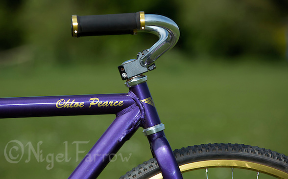 10 MAY 2015 - GREAT BLAKENHAM, GBR - When asked what colour she wanted her bike painted Ipswich Eagles Cycle Speedway Club's chocolate lover Chloe Pearce chose the purple as used by Cadbury and asked for her name to be added using the same typeface as the company (PHOTO COPYRIGHT © 2015 NIGEL FARROW, ALL RIGHTS RESERVED) (NIGEL FARROW/COPYRIGHT © 2015 NIGEL FARROW : www.nigelfarrow.com)