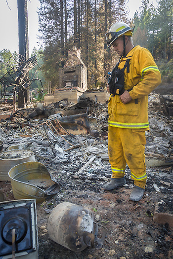 """Our crew was here and we thought the fire had bypassed my house.  We drove up the Highway and saved a neighbor's house while the fire circled back and hit my place...I lost everything.""  -Knights Valley Volunteer Fireman Bud Pochini  accesses the damage after the Tubbs Fire destroyed his home, shop and business near Calistoga. (Clark James Mishler)"