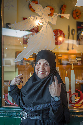 Mother Tabitha is thrilled to be photographed with the newly painted angle in the window of Cafe Sarafornia in downtown Calistoga. (Clark James Mishler)