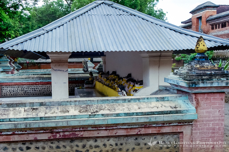 Nusa Tenggara, Lombok, Mataram. Pura Lingsar, under this roof in the Wektu Telu section you can see some sacred volcanic rocks dressed in yellow textiles. (Photo Bjorn Grotting)