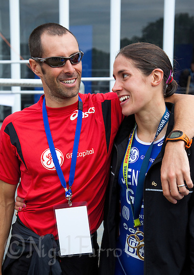 06 AUG 2011 - LONDON,GBR - Helen Jenkins (GBR) is hugged by husband and coach Marc Jenkins after her victory in the women's round of triathlon's ITU World Championship Series which made her eligible for the British team for the 2012 Olympic Games .(PHOTO (C) NIGEL FARROW) (NIGEL FARROW/(C) 2011 NIGEL FARROW)