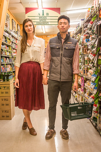 """Jon surprised me with a trip to wine country, but we are students, so we're here hoping to find an inexpensive bottle of wine."" -First year medical students Alex Murdock and Jonathan Liu shop at the CalMart in Calistoga. (Clark James Mishler)"