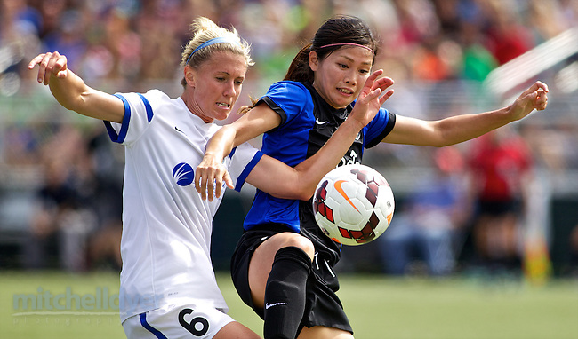 TUKWILA, WA - AUGUST 31:  Nahomi Kawasumi #9 of Seattle Reign FC fights for the ball against Jen Buczowski #6 of FC Kansas City in the first half of the National Women's Soccer League Championship on August 31, 2014 at Starfire Stadium in Tukwila, Washington.  (Photo by Craig Mitchelldyer/Getty Images) *** Local Caption *** Nahomi Kawasumi; Jen Buczowski (Craig Mitchelldyer/Getty Images)