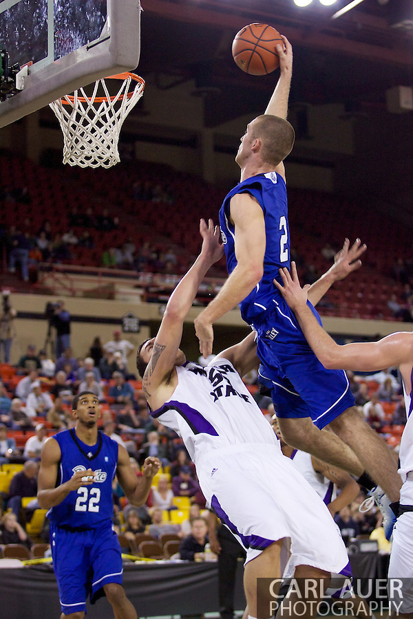 November 27th, 2010:  Anchorage, Alaska - Drake Bulldog forward Aaron Hawley (2) is fouled in his monster dunk attempt in the Bulldog's 81-82 loss to Weber State in the third place game of the Great Alaska Shootout. (Carl Auer)