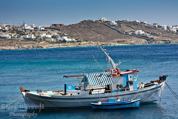 fishing boat at anchor off the shore of Mykonos in the Greek Islands (Ian C Whitworth)