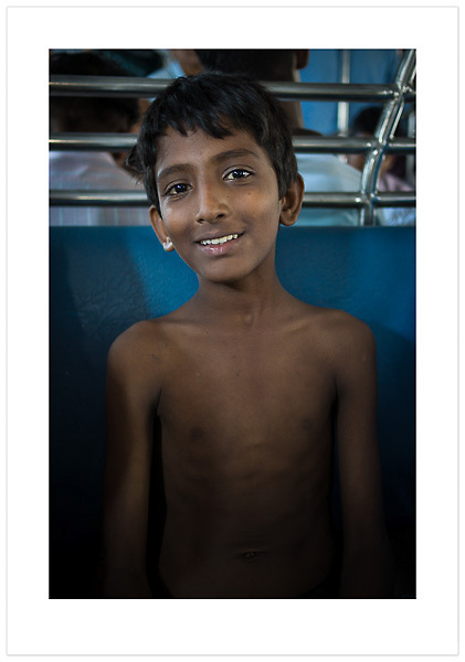 Boy on a Train - Mumbai, India (© 2013 Ian Mylam)