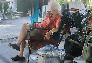 Homeowner Fay McDowell, of Zoar Baptist Church, rests on her patio as members of Southern Baptist Disaster Relief mud out her house, Aug. 22, 2016, in Baton Rouge, La. McDowell is one of thousands of Louisiana residents whose homes were damaged by flood waters, Aug. 12-15, 2016. Approximately 13 people died during the flood, and 20 parishes experienced severe damage. (Photo by Carmen K. Sisson) (Carmen K. Sisson/Cloudybright)