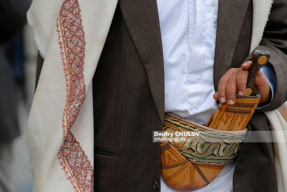 SANA'A, YEMEN - SEPTEMBER 18, 2006: Unidentified man wears janbiya in Sana'a, Yemen. Janbiya is a traditional dagger and a mandatory attribute of Yemeni men's suit. (Dmitry Chulov)